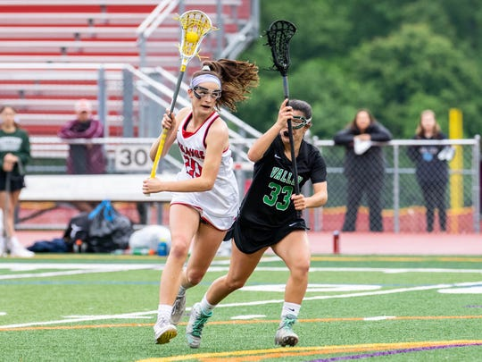 Northern Highlands midfielder #20 Julia Hill controlling the ball during the North 1, Group 3 Girls Lacrosse state sectional semi-finals at Northern Highlands High School. Tuesday, May 22, 2018.