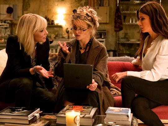 "From left, Cate Blanchett,  Helena Bonham Carter and Sandra Bullock in a scene from ""Ocean's 8."""
