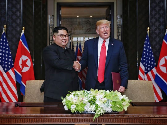 In this handout photograph provided by The Strait Times, North Korean leader Kim Jong-un with U.S. President Donald Trump during their summit at the Capella Hotel on Sentosa island on June 12 in Singapore.