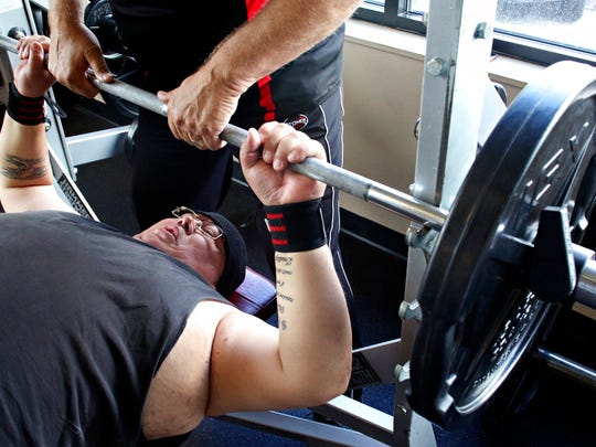 In this June 14, 2018 photo, power lifter Sylvester Vermillion trains at the Wave Aquatic and Fitness Center in Whitefish, Mont. At the 2018 Montana Special Olympics State Games, Vermillion squatted 405 pounds. He also bench-pressed 230 and deadlifted 430, winning each individual event and, with a collective 1,065 pounds, the combined powerlifting title as well.  (Justin Franz/Flathead Beacon via AP)