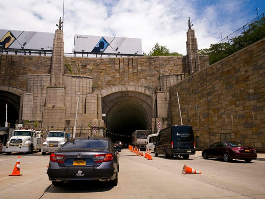 Traffic on Route 495 enters the Lincoln Tunnel enroute to New York City, Thursday, June 21, 2018, in Weehauken, N.J.