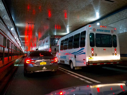 Traffic moves through the Lincoln Tunnel enroute to