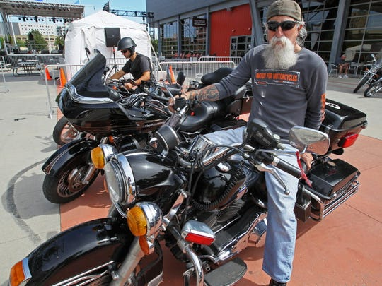 Tony Sanfelipo of Milwaukee sits astride his 2005 Police Road King model Harley-Davidson.