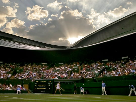 Karolina Pliskova of the Czech Republic plays a return to Mihaela Buzarnescu of Romania during their women's singles match on the fifth day at the Wimbledon Tennis Championships in London, Friday July 6, 2018.