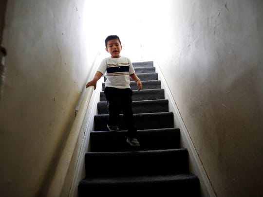Franco Perez cries as he runs downstairs from his family's apartment in Covington, Ky., on April 28, 2018, looking for his father, Edgar Perez Ramirez, who had walked outside for a moment. Months after U.S. Immigration and Customs Enforcement agents arrested his father, the 4-year-old still shows more aggression toward his classmates and panics if his father leaves him for more than a few minutes. (AP Photo/Gregory Bull)