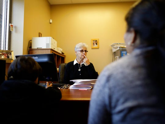 Sister Juana Mendez, center, speaks to a Guatemalan