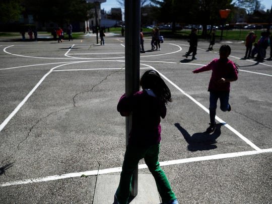 Children play at recess at John G. Carlisle Elementary