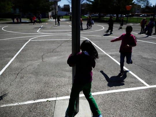 Children play at recess at John G. Carlisle Elementary