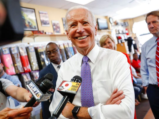 Former Vice President Joe Biden speaks to the media during a campaign stop with Democratic gubernatorial candidate Richard Cordray at the Beyond Image Barber Salon, Friday, June 29, 2018, in Cincinnati.