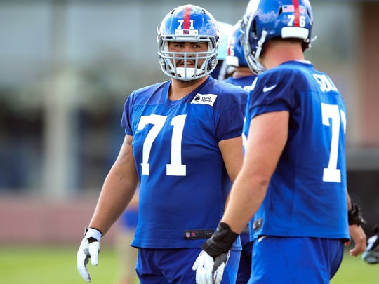 New York Giants offensive guard Will Hernandez (71) talks with offensive tackle Nate Solder (76) during training camp at Quest Diagnostics Training Center.
