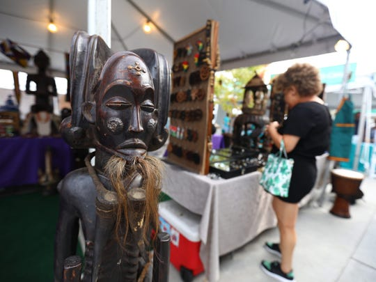 Authentic antique pieces from all over Africa are displayed at one of the tents at the Black Arts festival.