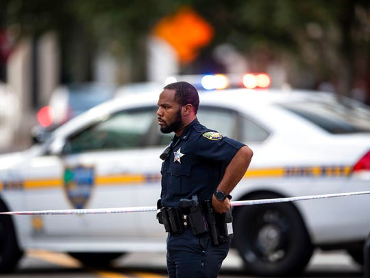 A police officer stands by where an active shooter was reported Sunday, Aug. 26, 2017 in Jacksonville, Fla. after a gunman opened fire Sunday during an online video game tournament that was being livestreamed from a Florida mall, killing multiple people and sending many others to hospitals. (AP Photo/Laura Heald)