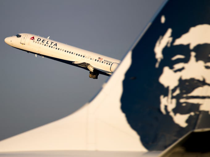 A Delta Air Lines Boeing 717 takes off from Seattle-Tacoma