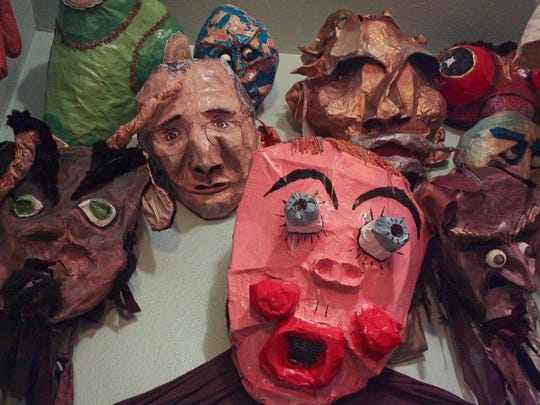 View of a group of masks at the Squallis Puppeteers'