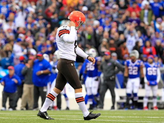 Cleveland Browns kicker Billy Cundiff walks back to the bench after missing a field goal against the Buffalo Bills during the first half of an NFL football game, Sunday, Nov. 30, 2014, in Orchard Park, N.J. (AP Photo/Bill Wippert)