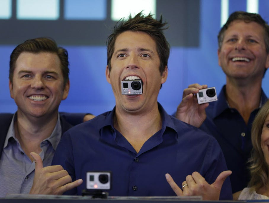 GoPro's CEO Nick Woodman holds a GoPro camera in his mouth as he celebrates his company's IPO at the Nasdaq MarketSite in New York, Thursday, June 26, 2014. GoPro, the maker of wearable sports cameras, loved by mountain climbers, divers, surfers and