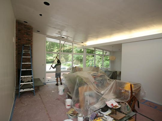 The living room of this 1957 mid-century modern home in Rye Brook is undergoing a makeover.  Here it is pictured July 22, 2014.