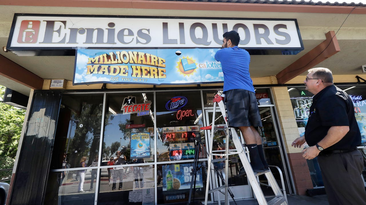 Store owner celebrates winning lottery sale