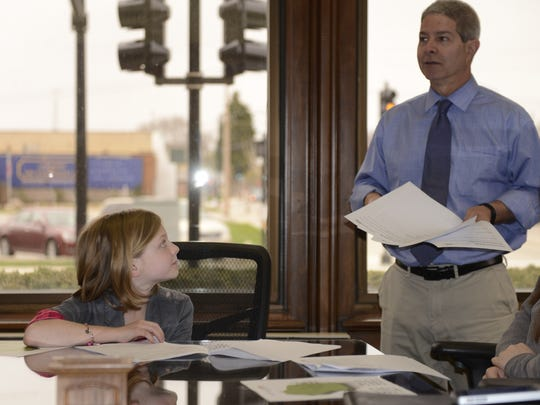 Press-Gazette Executive Editor Robert Zizzo explains newspaper reporting Thursday during Take Your Child to Work Day.