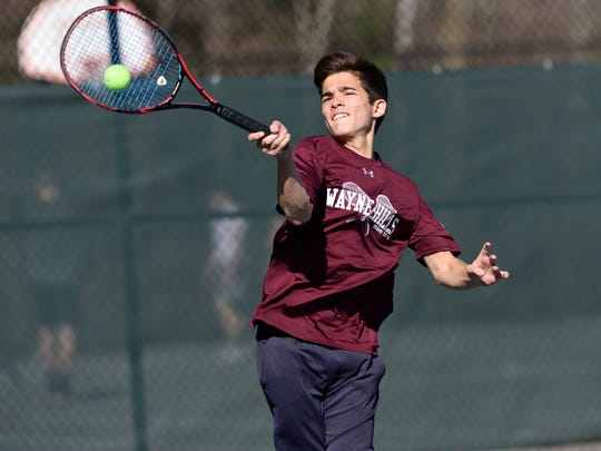 Jeffrey Augello of Wayne Hills plays in the finals of Passaic County boys tennis tournament at West Millford High School on Thursday.