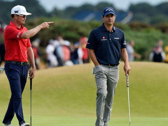 Zach Johnson and Kevin Kisner walk onto the 16th green