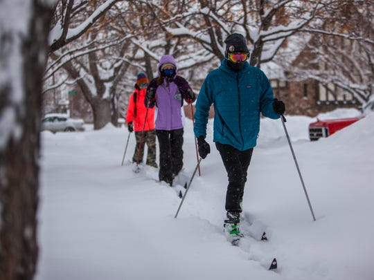 Southern Utah students Collin Stafford (right), Sage Dudley (middle) and Annabelle Schwab (left) take full advantage of the university's snow day by cross-country skiing around town, Monday, Feb. 1, 2016.
