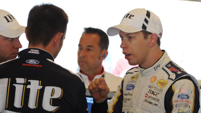 Brad Keselowski talks to the crew during final practice for the 2014 Brickyard 400 Saturday July 26, 2014 at The indianapolis Motor Speedway.