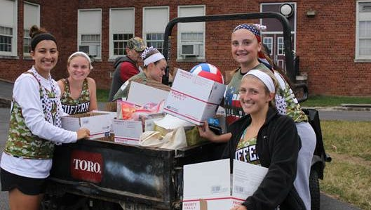 Suffern field hockey players Kate Lenihan, Grace Krebs, Alyssa Sanchez, Maria Frascone and Meghan McCarren load boxes of goods collected for soldiers at their team's Military Appreciation Game.