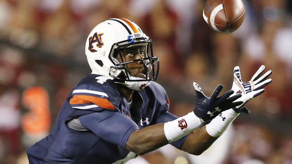 Auburn wide receiver Jason Smith (4) tips a pass to himself before scoring a touchdown during the second half of an NCAA college football game against Alabama, Saturday, Nov. 28, 2015, in Auburn, Ala. (AP Photo/Gerald Herbert)