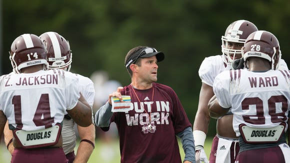 Mississippi State defensive coordinator Manny Diaz works with players during camp.