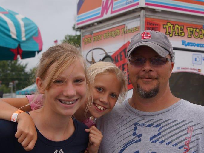 Robert Meyer with Makenzie and Katie Meyer