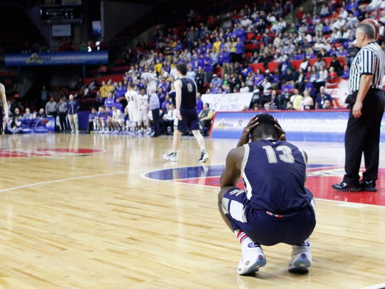 Our Lady of Lourdes High School's Kevin Townes reacts to the team's loss in the state Class A final to Irondequoit in March.