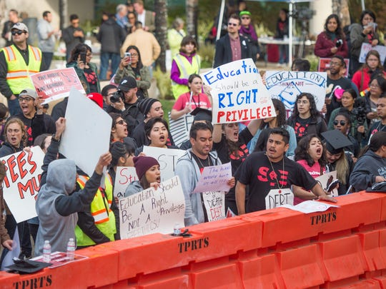 Students and supporters protest outside of the California State University Office of the Chancellor in Long Beach Wednesday as trustees voted to increase tuition by 5 percent.