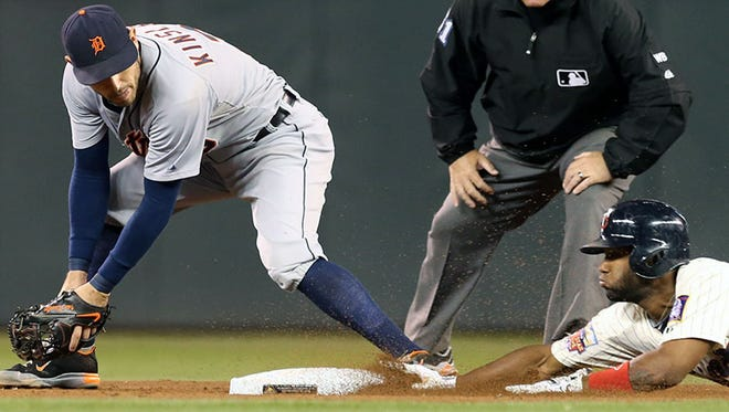 Tigers second baseman Ian Kinsler fields the ball as the Twins' Danny Santana slides into second base during Wednesday's game in Minneapolis.