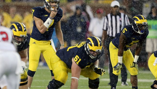 Michigan QB Shane Morris looks over the Utah defense in the rain during today's loss in Ann Arbor.
