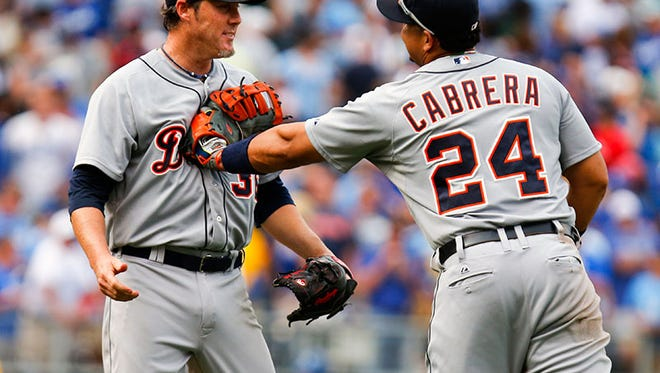 Tigers closer Joe Nathan and first baseman Miguel Cabrera celebrate the 3-2 win over the Royals Saturday in Kansas City, Mo.