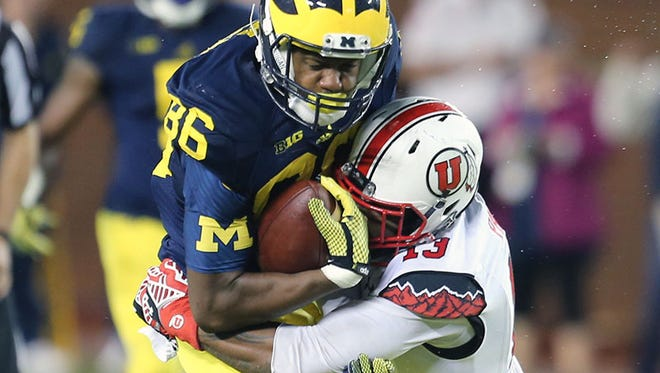 Michigan WR Jehu Chesson is tackled by Utah's Gionni Paul during the fourth quarter Saturday in Ann Arbor.