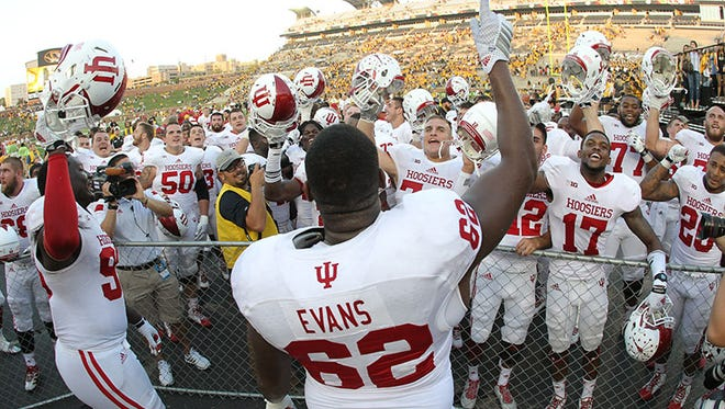 Indiana's Ralston Evans leads his teammates in a school song after a 31-27 win over Missouri Tigers on Saturday in Columbia, Mo.