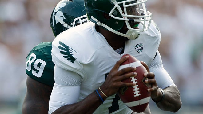 Eastern Michigan QB Rob Bolden is tackled by Michigan State defensive lineman Shilique Calhoun during Saturday's game in East Lansing.