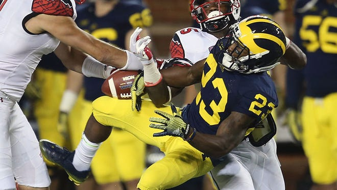 Michigan WR Dennis Norfleet can't come up with this pass against Utah Saturday in Ann Arbor.