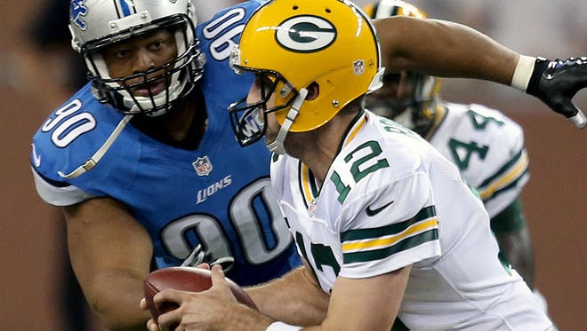 Lions DT Ndamukong Suh chases down Packers QB Aaron Rodgers during Sunday's win at Ford Field.