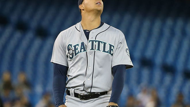 Mariners pitcher Taijuan Walker reacts after getting the final out of the seventh inning of tonight's game in Toronto.