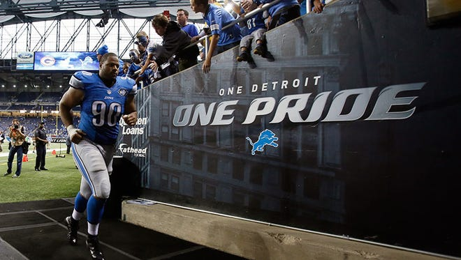 Lions DT Ndamukong Suh runs off the field Sunday at Ford Field.
