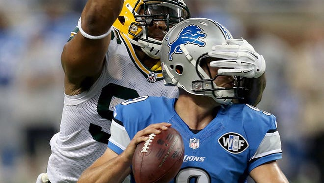 Lions QB Matthew Stafford is sacked by Packers LB Mike Neal during Sunday's game at Ford Field.