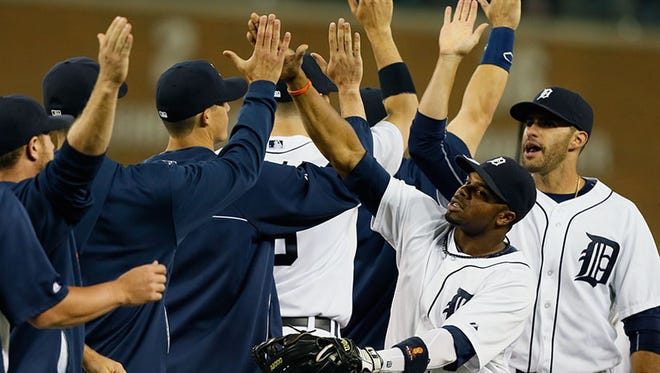 The Tigers celebrate Thursday's win over the Twins.