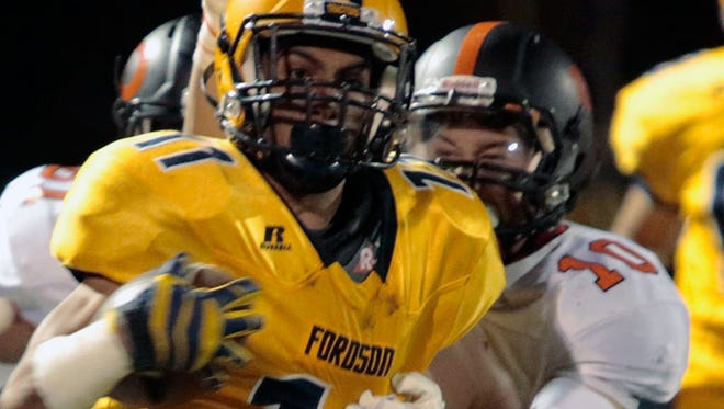 Dearborn's Ahmad Hazime chases down Dearborn Fordson's Hefdadeen Mashrah as he runs along the sideline during Fordson's 35-0 win Friday at Fordson.