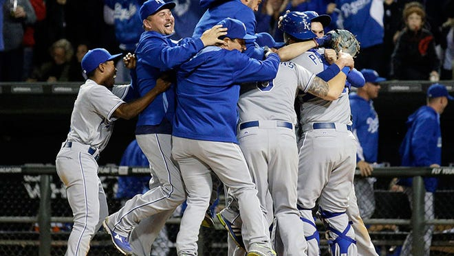 The Royals celebrate the win over the White Sox Friday in Chicago, clinching a playoff spot for the first time since 1985.
