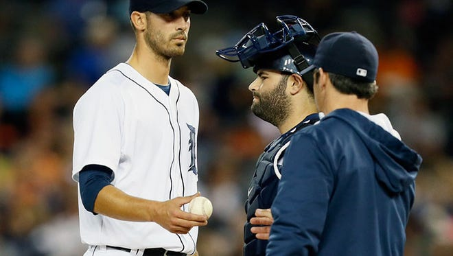 Tigers manager Brad Ausmus takes the ball away from Rick Porcello during the 11-4 loss Friday at Comerica Park.