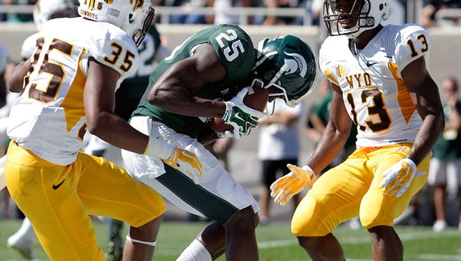 Michigan State wide receiver Keith Mumphrey catches a touchdown during Saturday's win over Wyoming.