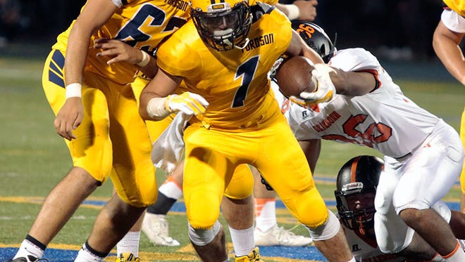 Dearborn Fordson's Jamil Sabbagh carries the ball in the win over Dearborn on Friday.